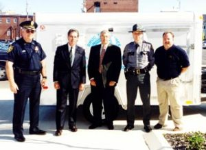 (l-r) Retired Bowling Green Police Chief Gary Raymer, Congressman Ron Lewis, DTF Director Thomas M. Loving, Kentucky State Police Sergeant Herman Hall, ATF Special Agent Terry Vance are pictured in front of a Bowling Green - Warren County Drug Task Force Trailer used to process and contain Clandestine Methamphetamine Laboratories. Three of these trailers were purchased with a grant secured by Congressman Ron Lewis.